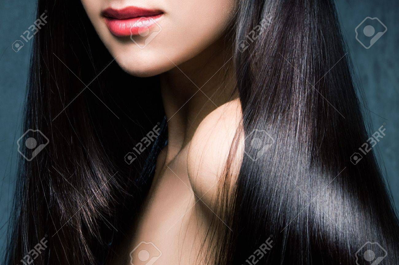 woman with long shiny black hair and red lips studio shot - 15175431