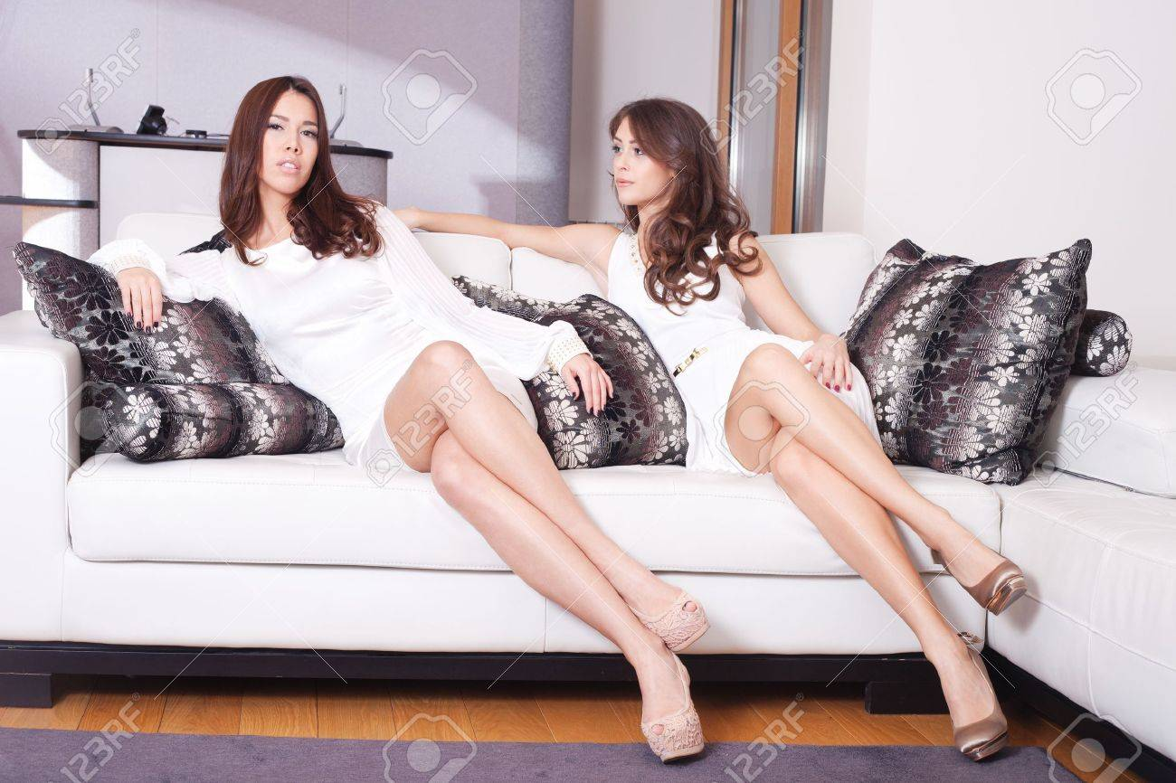 couple of elegant young women sit in living room Stock Photo - 16847794