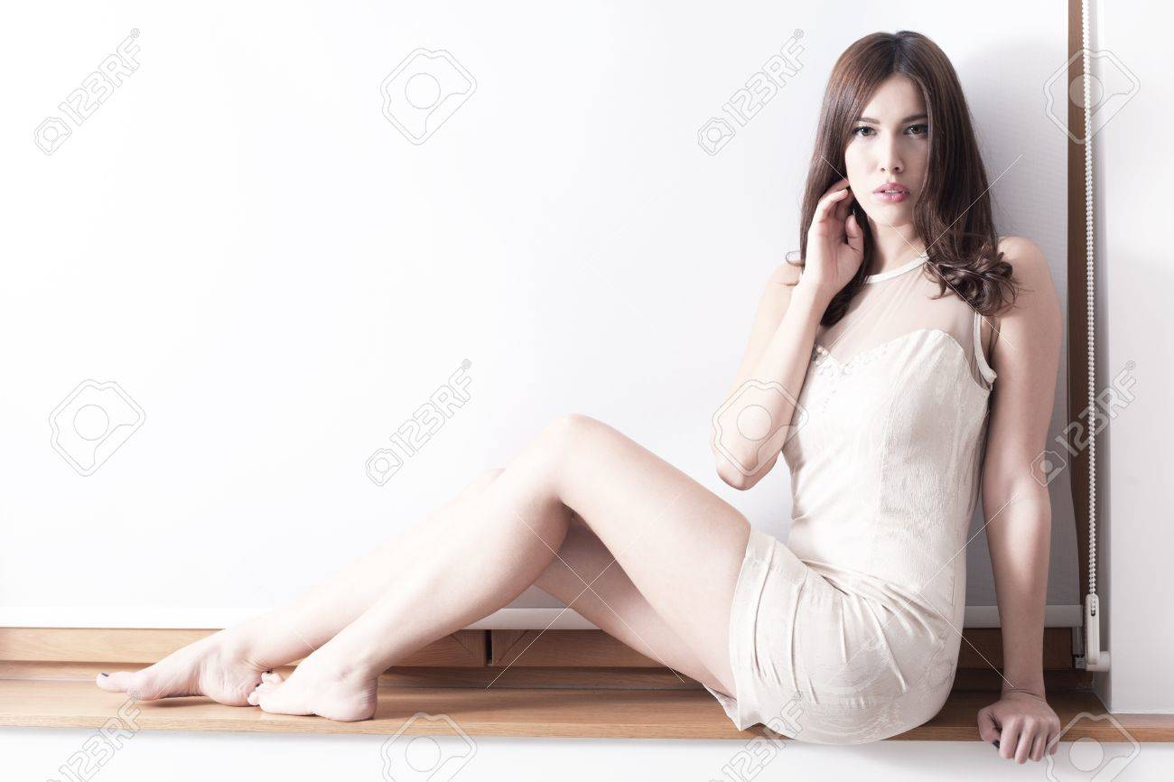 barefoot elegant young woman full body shot indoor shot Stock Photo - 17049495