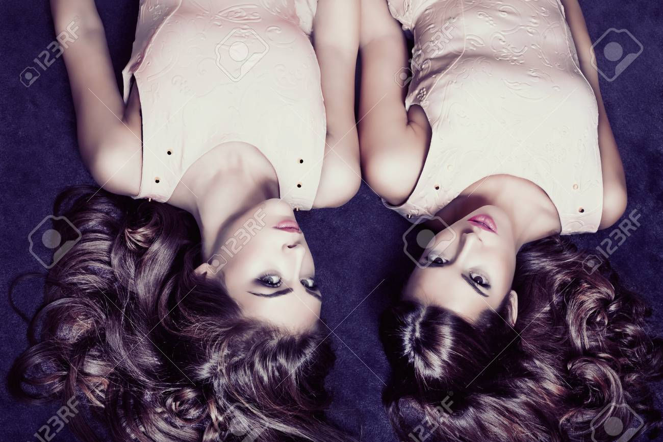 couple of young women with shiny silky healthy hair Stock Photo - 17255290