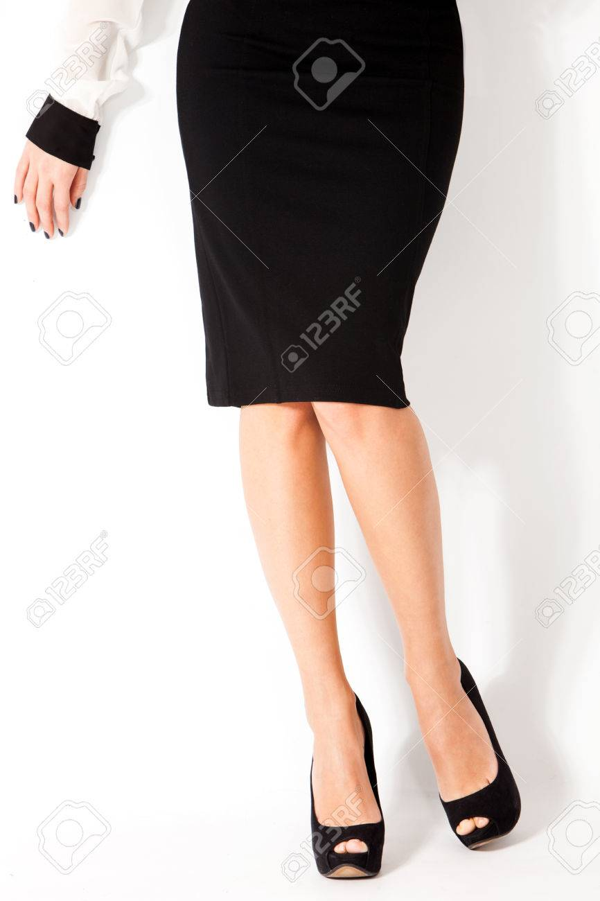 977d4a28a Woman In Elegant Tight Black Skirt And High Heel Shoes Stock Photo ...