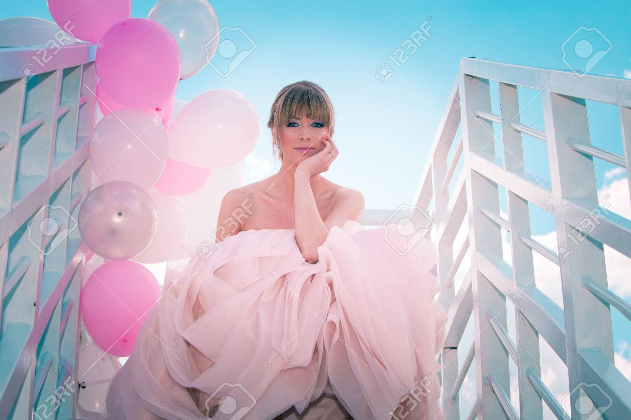 Young Beautiful Woman In Elegant Wedding Dress Hold Balloons.. Stock ...
