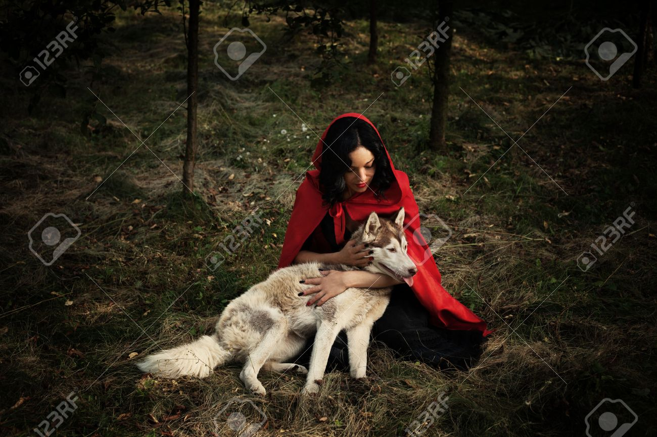 red riding hood and the wolf outdoor in the wood Standard-Bild - 35695717