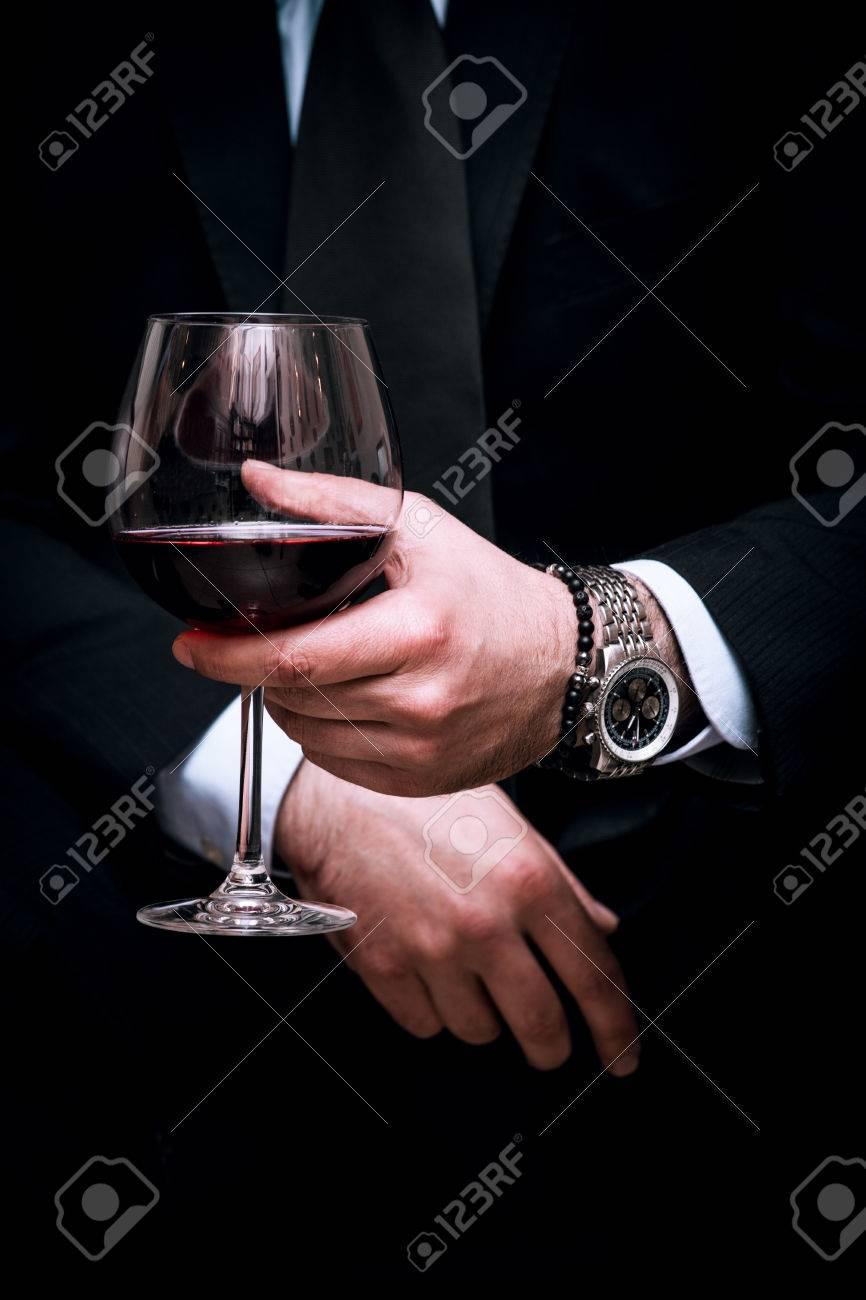 adult elegant man hold glass of red wine, close up, indoor shot, selective focus Standard-Bild - 38123431