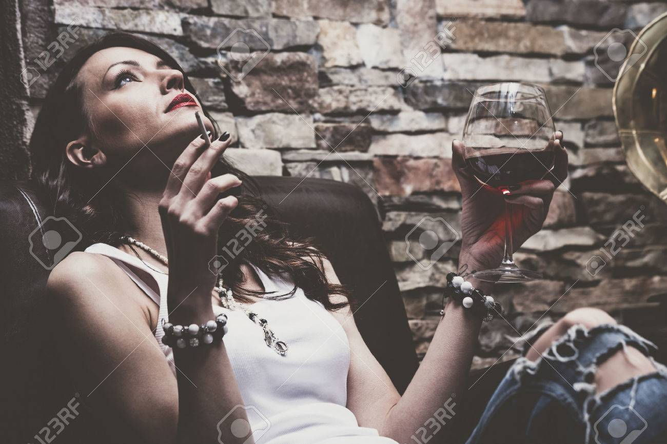 Remarkable Woman With Glass Of Red Wine And Cigarette Wearing Blue Jeans Inzonedesignstudio Interior Chair Design Inzonedesignstudiocom
