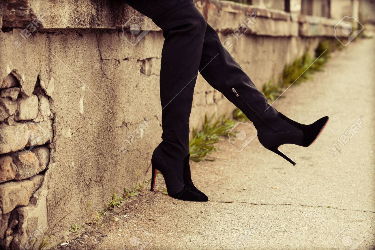 young woman in  high heels boots,  outdoor on street, closeup Standard-Bild - 47346505