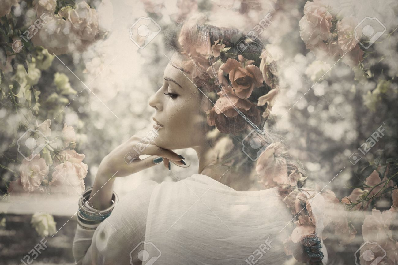fantasy beautiful young woman like fairy, double exposure with roses, small amount of grain added Standard-Bild - 47766637