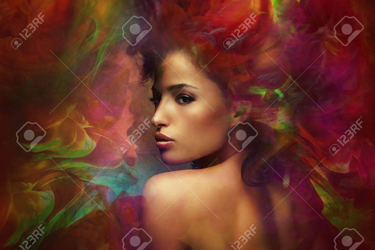 fantasy colorful beautiful young woman portrait, composite photo Standard-Bild - 47935050