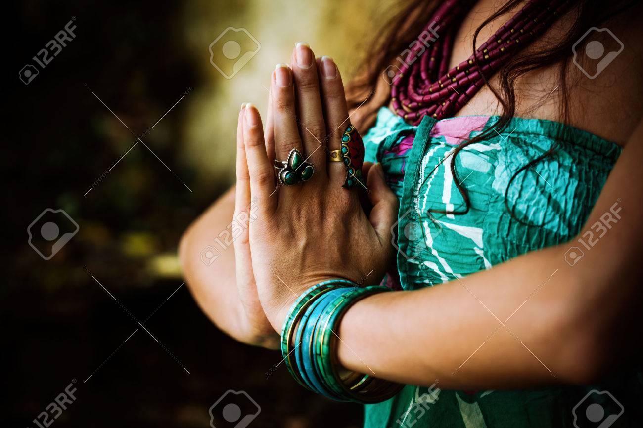 woman practice yoga outdoor close up of hands in namaste gesture Standard-Bild - 63850290