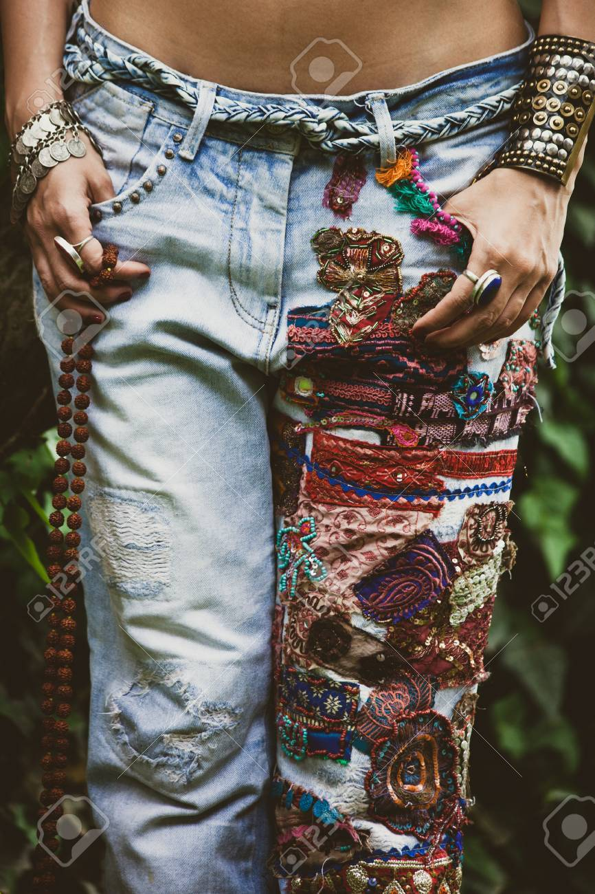 339a1e4e3b0bd closeup of woman in embroidered jeans in boho style Stock Photo - 64163828