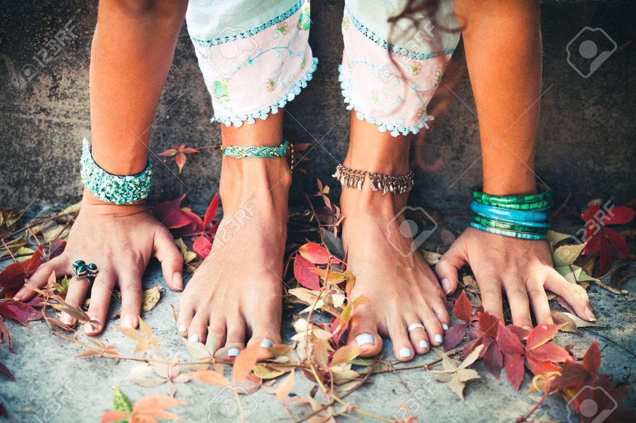 closeup of woman hands and feet practice yoga extension outdoor Standard-Bild - 64570438