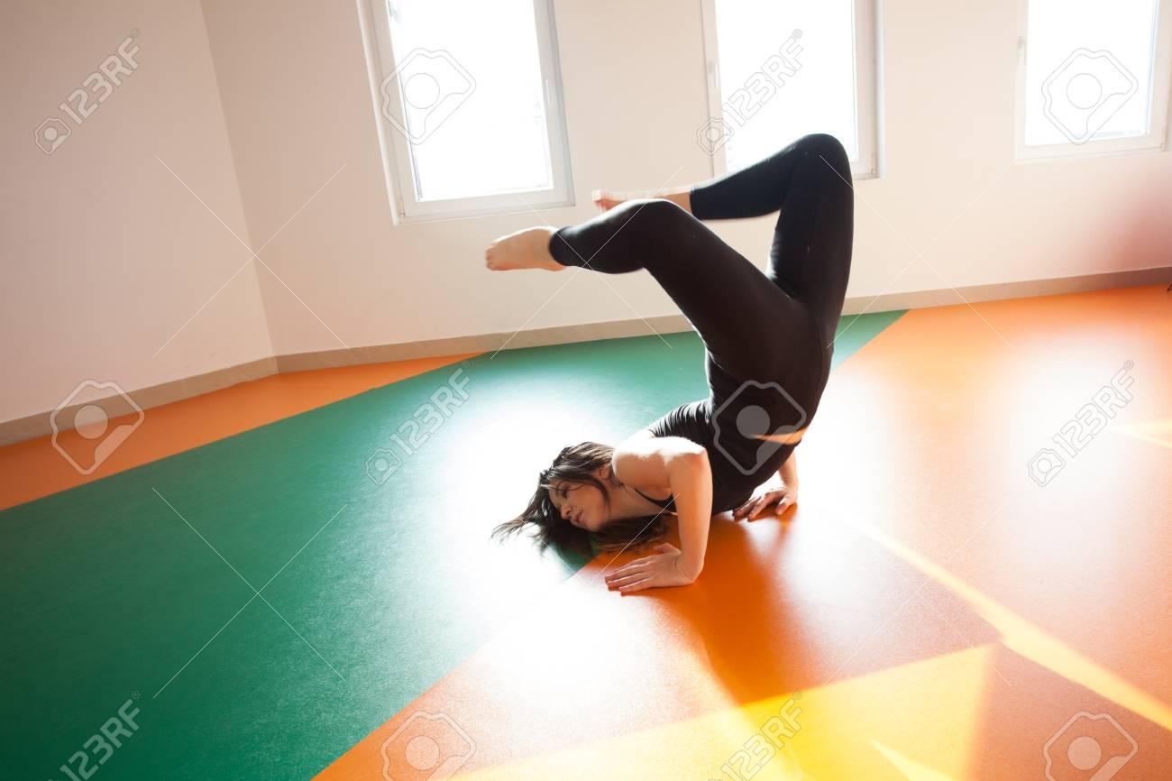 Young Dancer Woman Practice Floor Jump On Modern Ballet Class