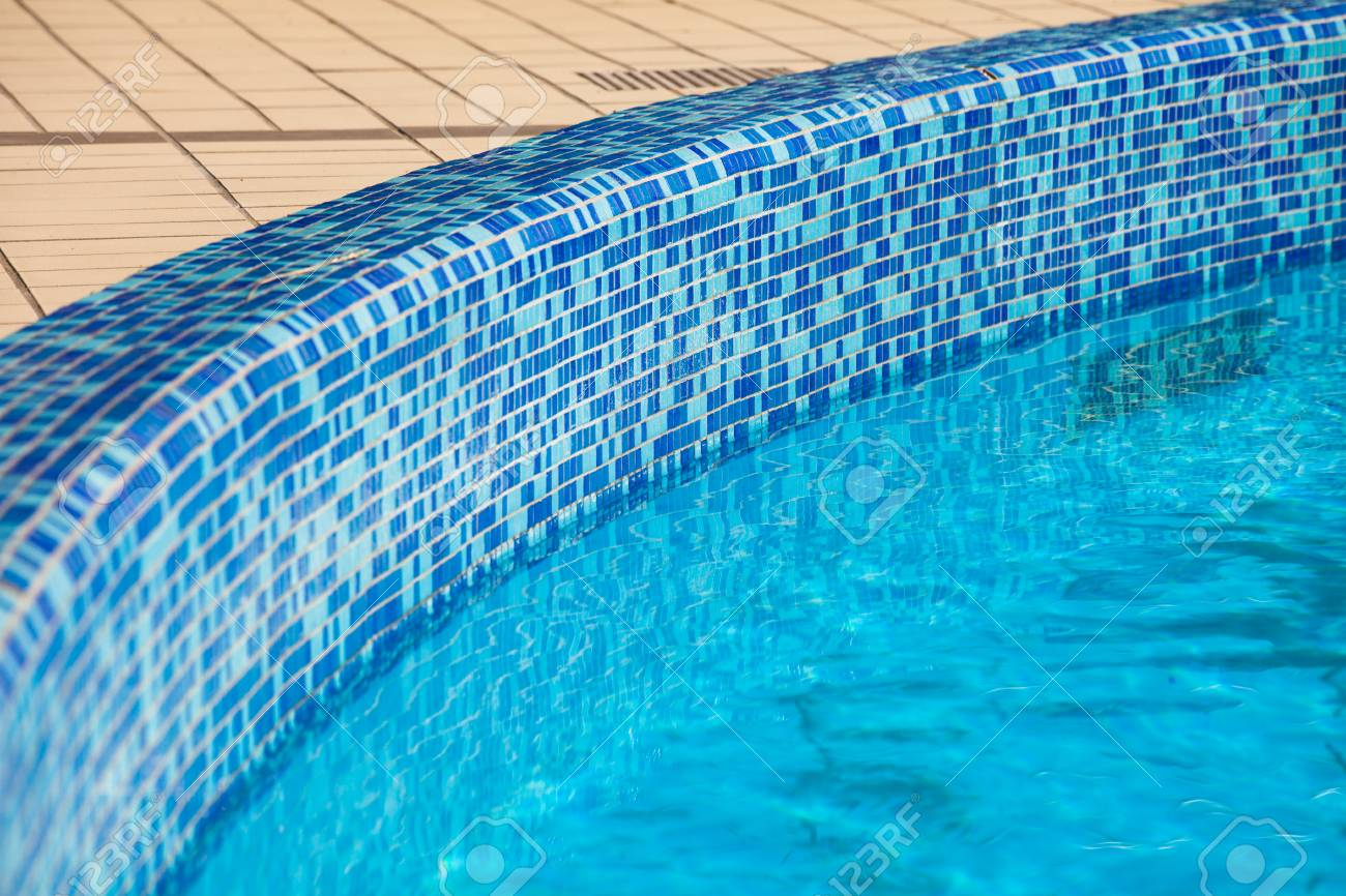 tiled edge of swimming pool background