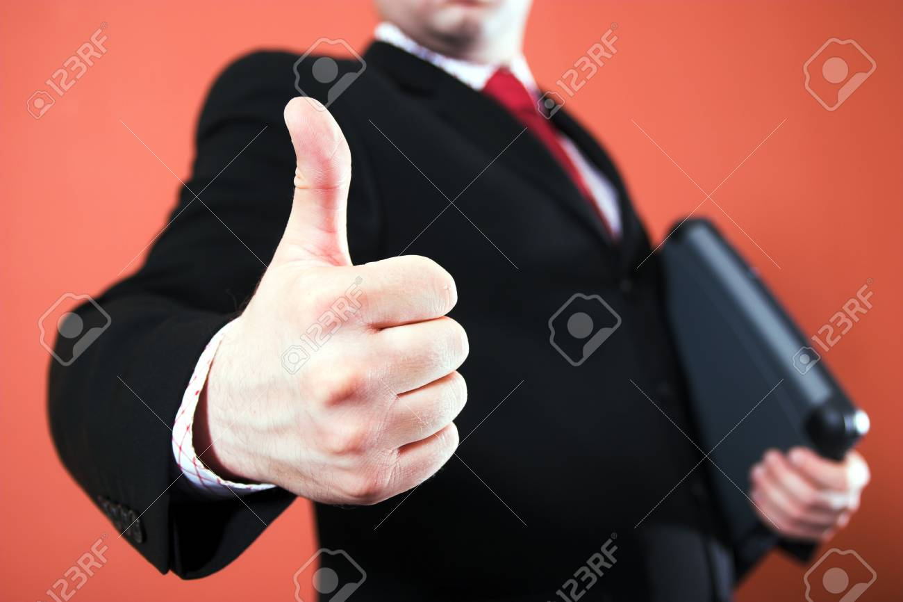 Businessman showing thumb up Stock Photo - 1415800