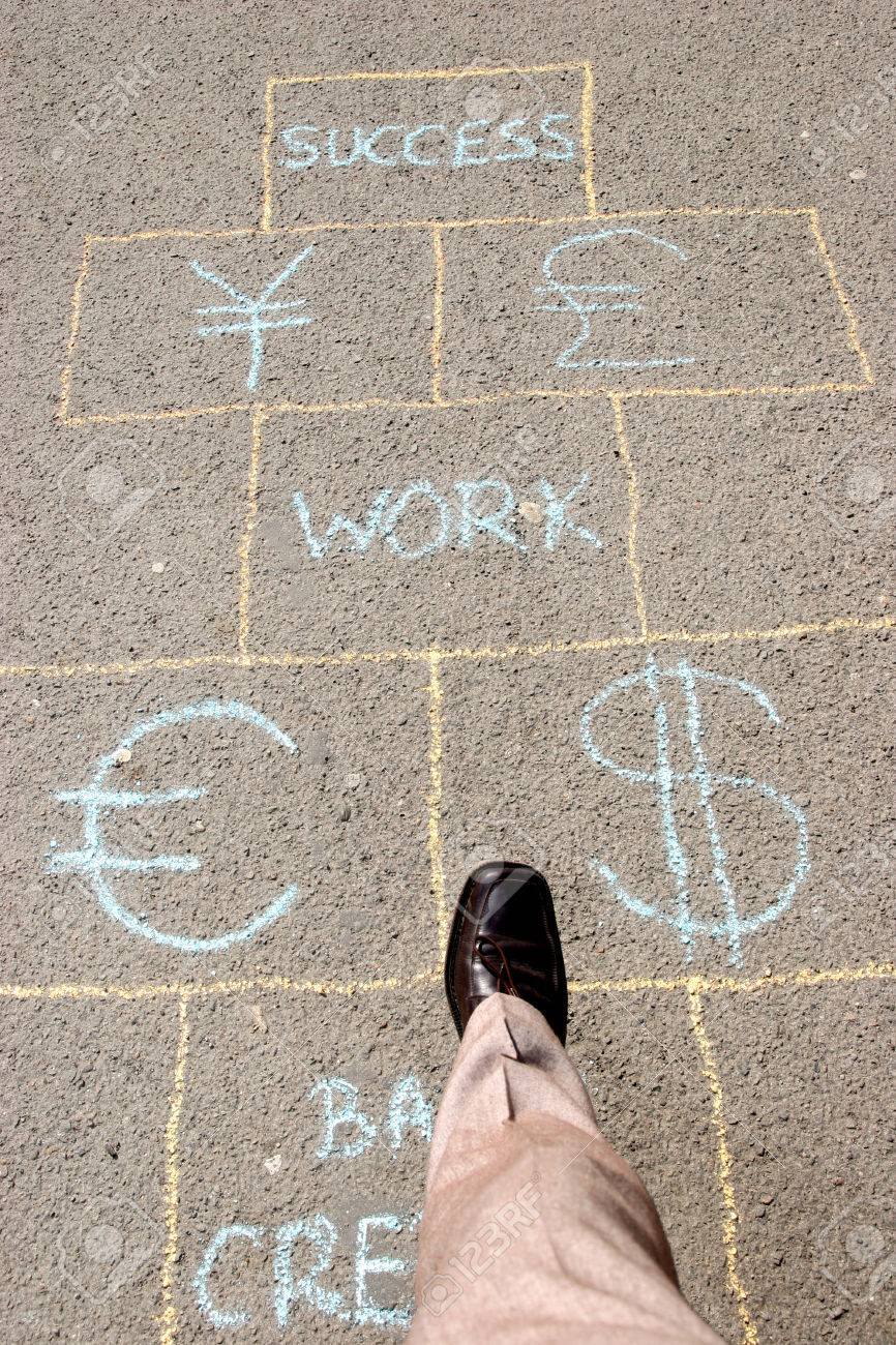 Man playing a business hopscotch Stock Photo - 1533699