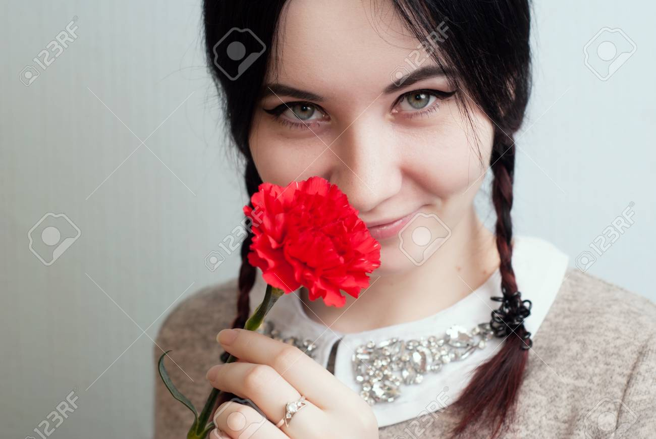 Playful Girl Holding A Red Carnation, Flower In Mouth, Portrait ...