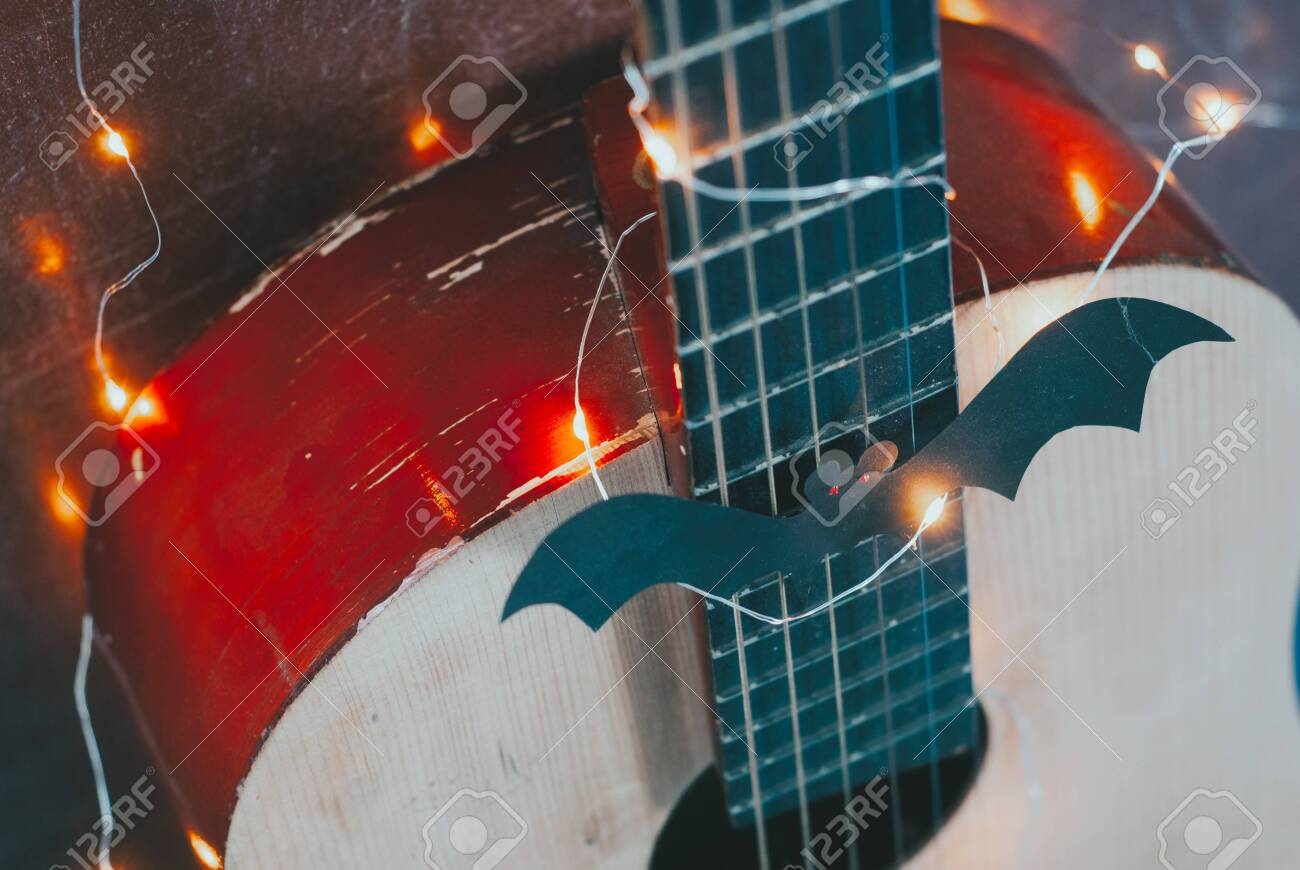 Acoustic Guitar In Autumn Season Guitar With Garland And Bat Stock Photo Picture And Royalty Free Image Image 132112214