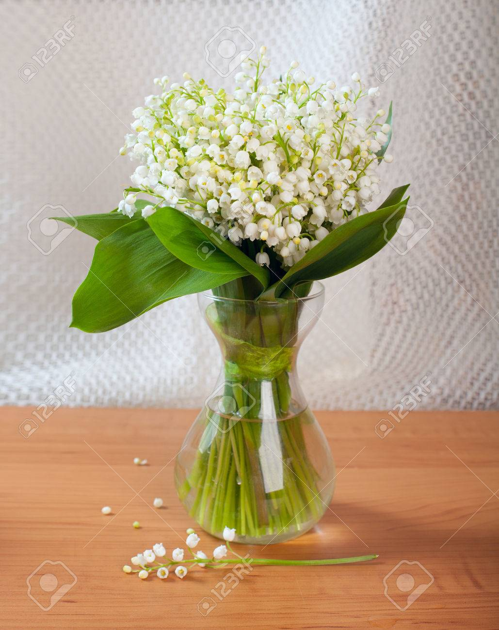 Bouquet of lilies of the valley in glass vase on table stock photo bouquet of lilies of the valley in glass vase on table stock photo 28426110 reviewsmspy