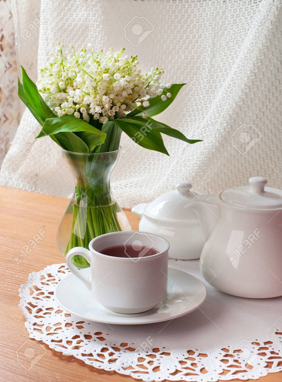 morning tea table setting with Lily of the valley flowers bouquet Stock Photo - 28426118 & Morning Tea Table Setting With Lily Of The Valley Flowers Bouquet ...