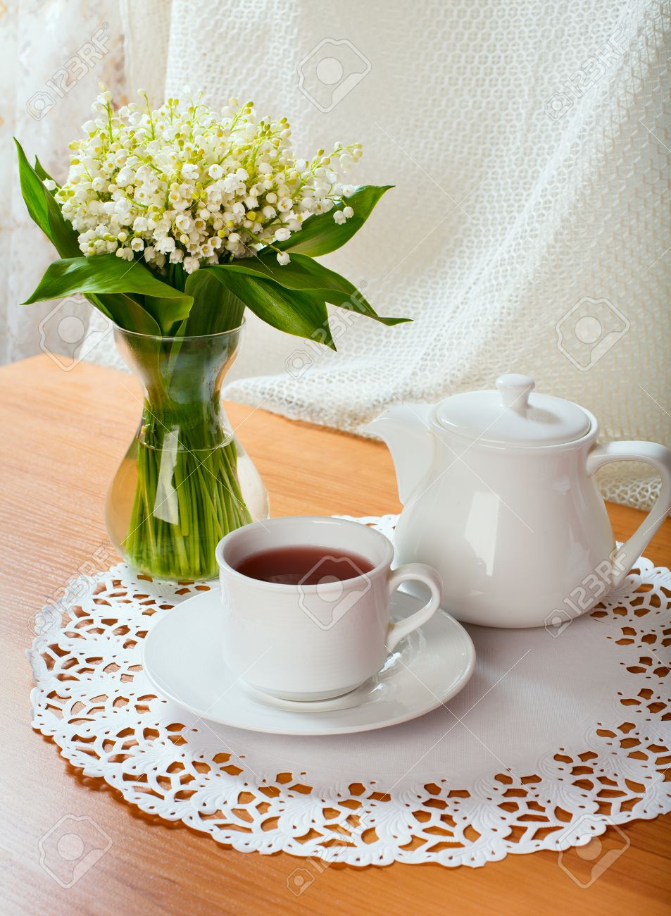 morning tea table setting with Lily of the valley flowers Stock Photo - 28426120 & Morning Tea Table Setting With Lily Of The Valley Flowers Stock ...