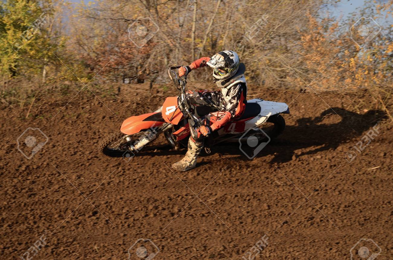 RUSSIA, SAMARA, CHAPAYEVSK - OCTOBER 17: Motorcycle racer S. Nikishkin turns with proslipping and large slope, the Open Cup