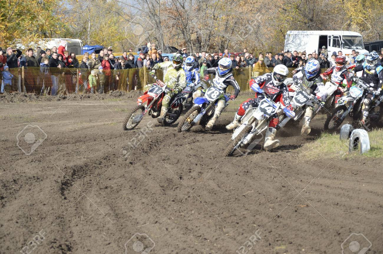 RUSSIA, SAMARA, CHAPAYEVSK - OCTOBER 17: Start, a group of motorbike racing in the MX2 class competition in the first corner the Open Cup