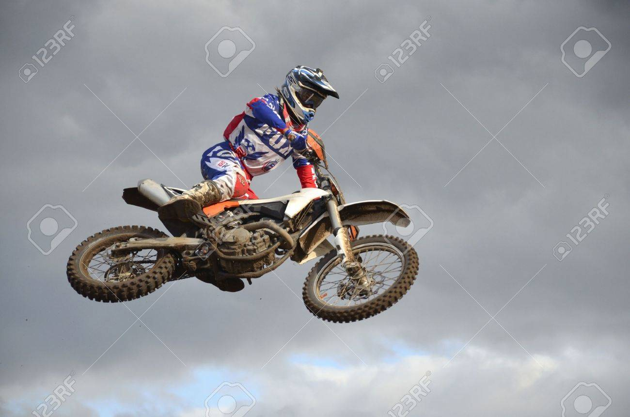 RUSSIA, SAMARA, CHAPAYEVSK - OCTOBER 17: The spectacular jump motocross racer A. Nikishkin on the background a stormy sky the Open Cup