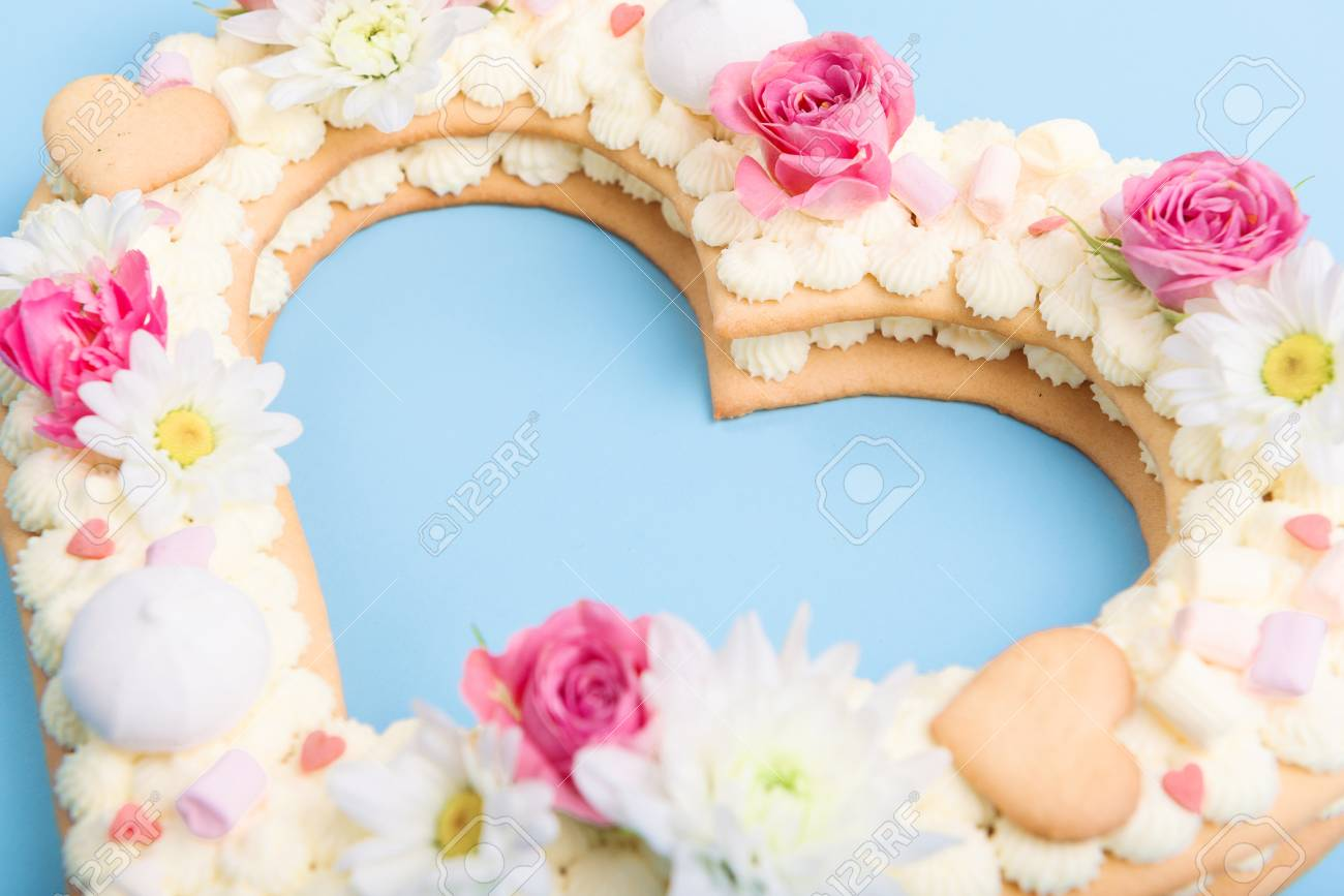 Valentines Day Heart Shaped Cake With Flowers As Decoration