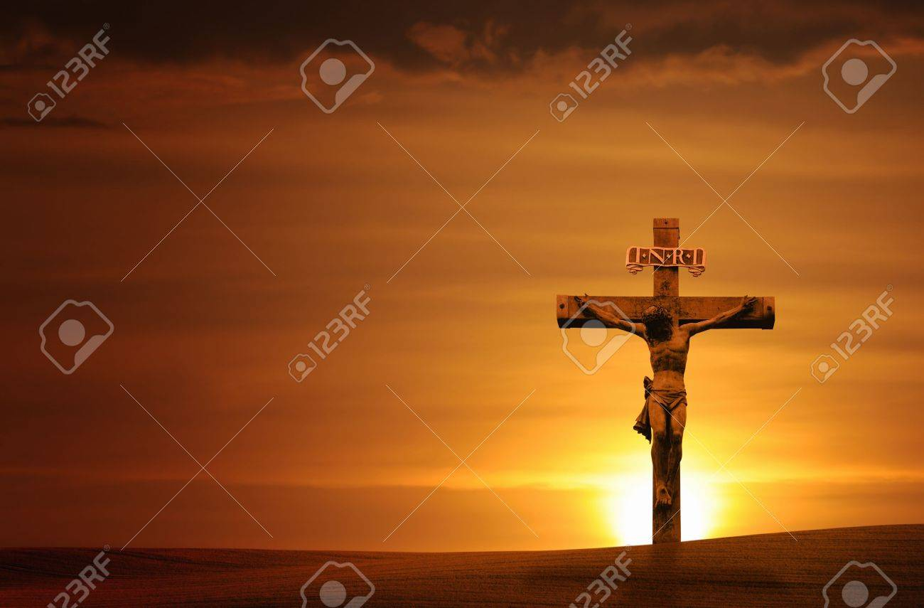 Cross at sunset with a dramatic sky - horizontal. - 5654423
