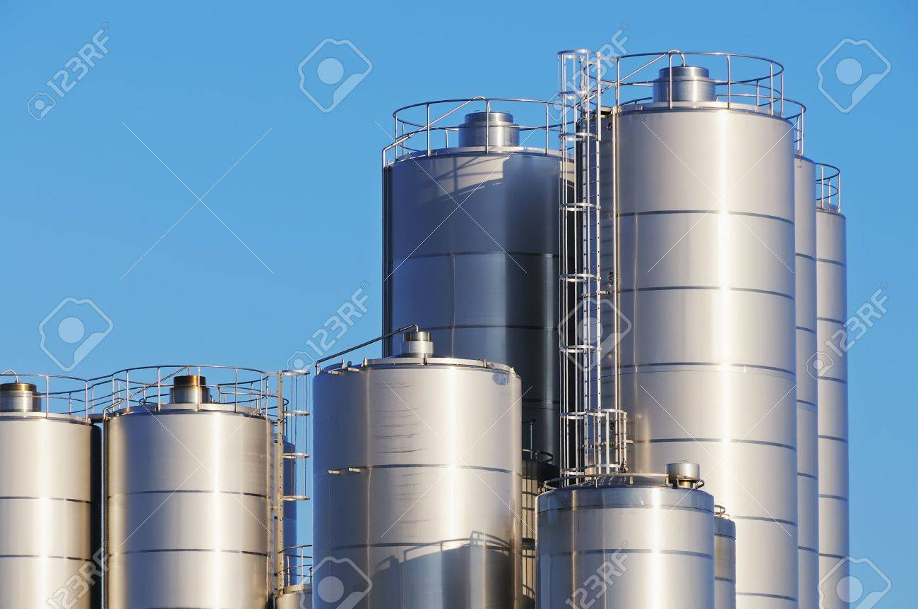 Close up shot of storage tanks of dairy plant against blue sky. Stock Photo - 6604435