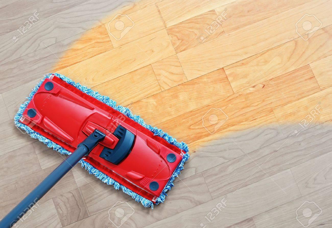 housework - sweeper wet mop on laminate floors. stock photo