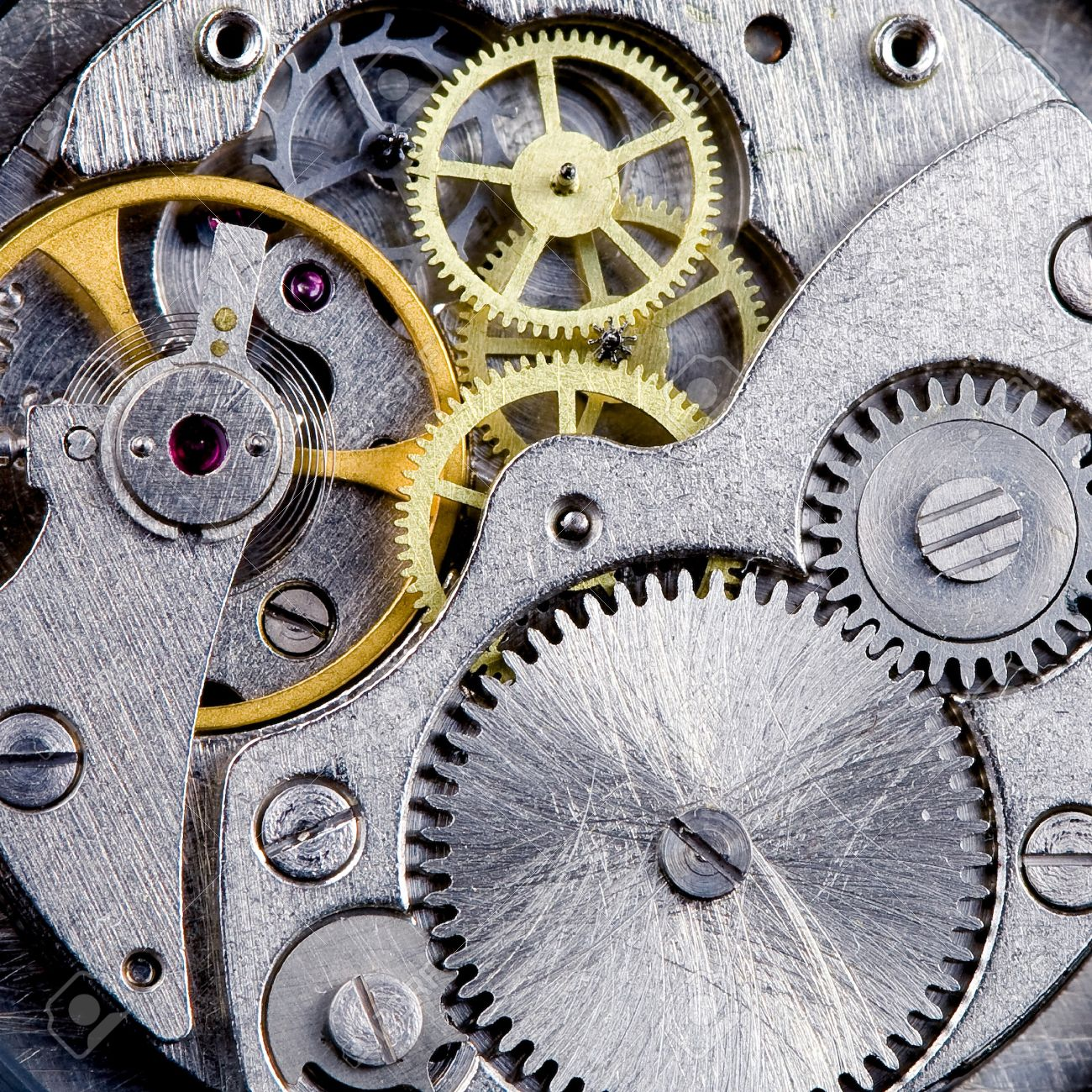 Part of clockwork with gears, spring, ruby. Steel and brass. Stock Photo - 8911868