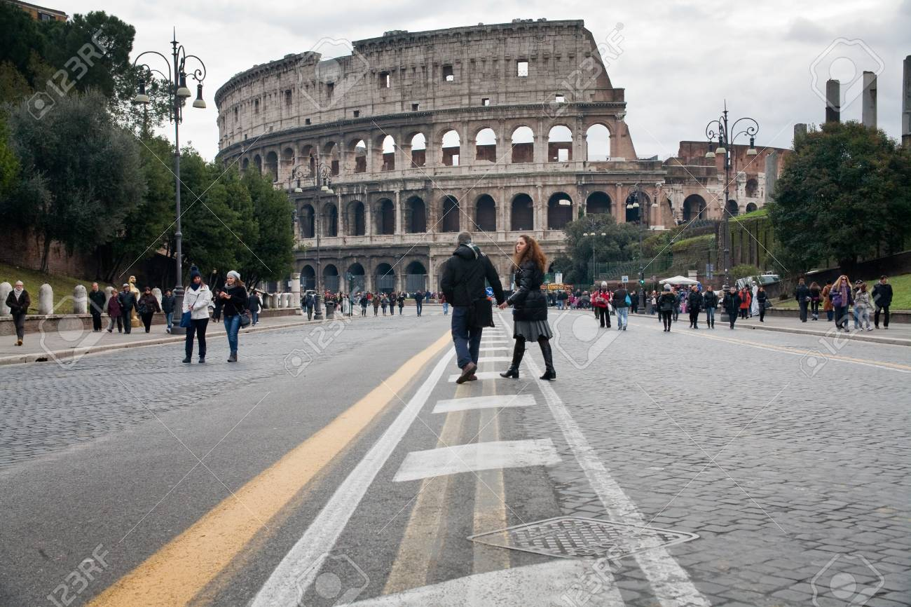 tourists walk to Colosseum in Rome on December 19, 2010 Stock Photo - 9433878