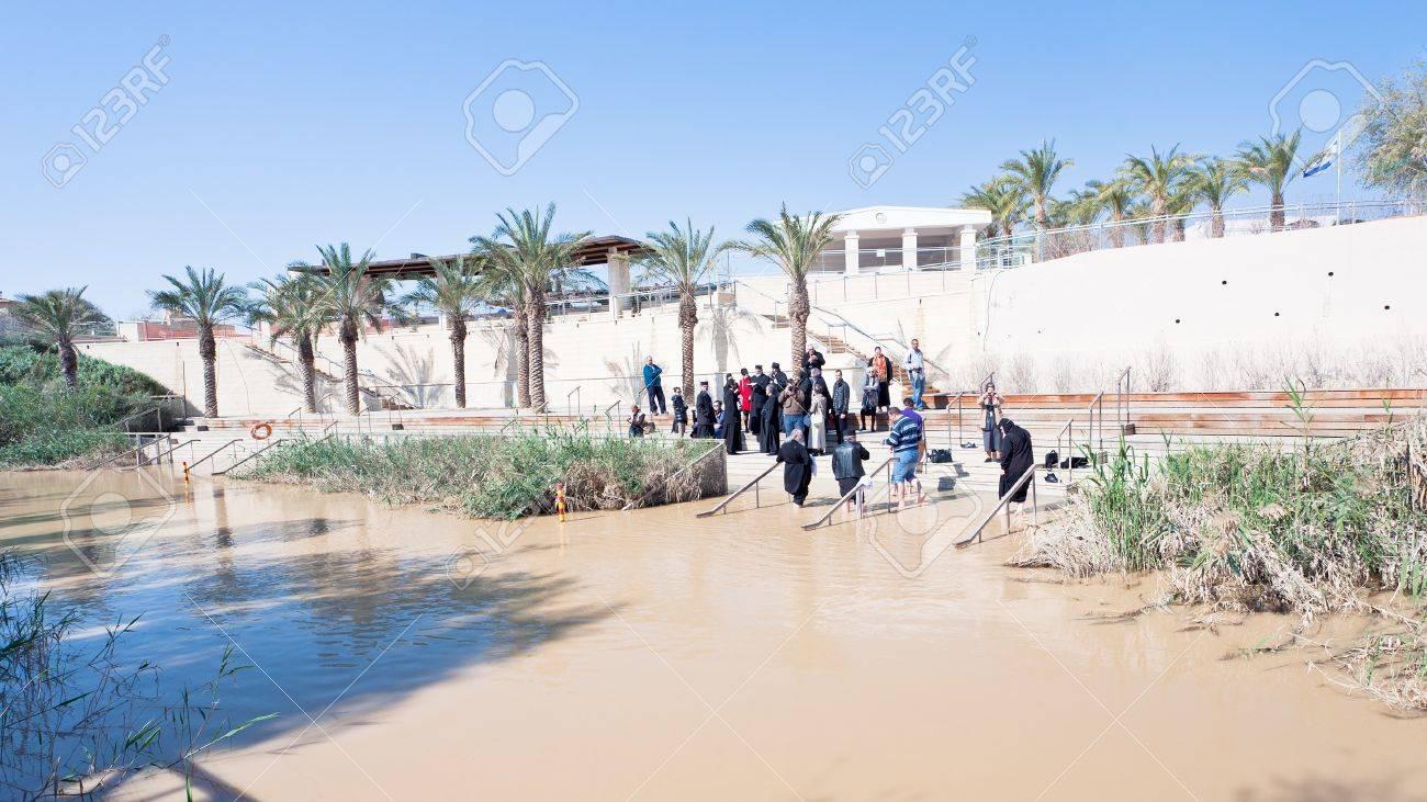 jordan river jordan february 20 priests baptize people in
