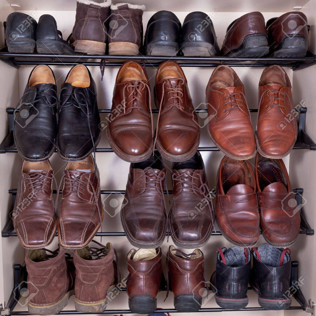 Shoes Cabinet With Used Leather Men's Slippers Stock Photo ...