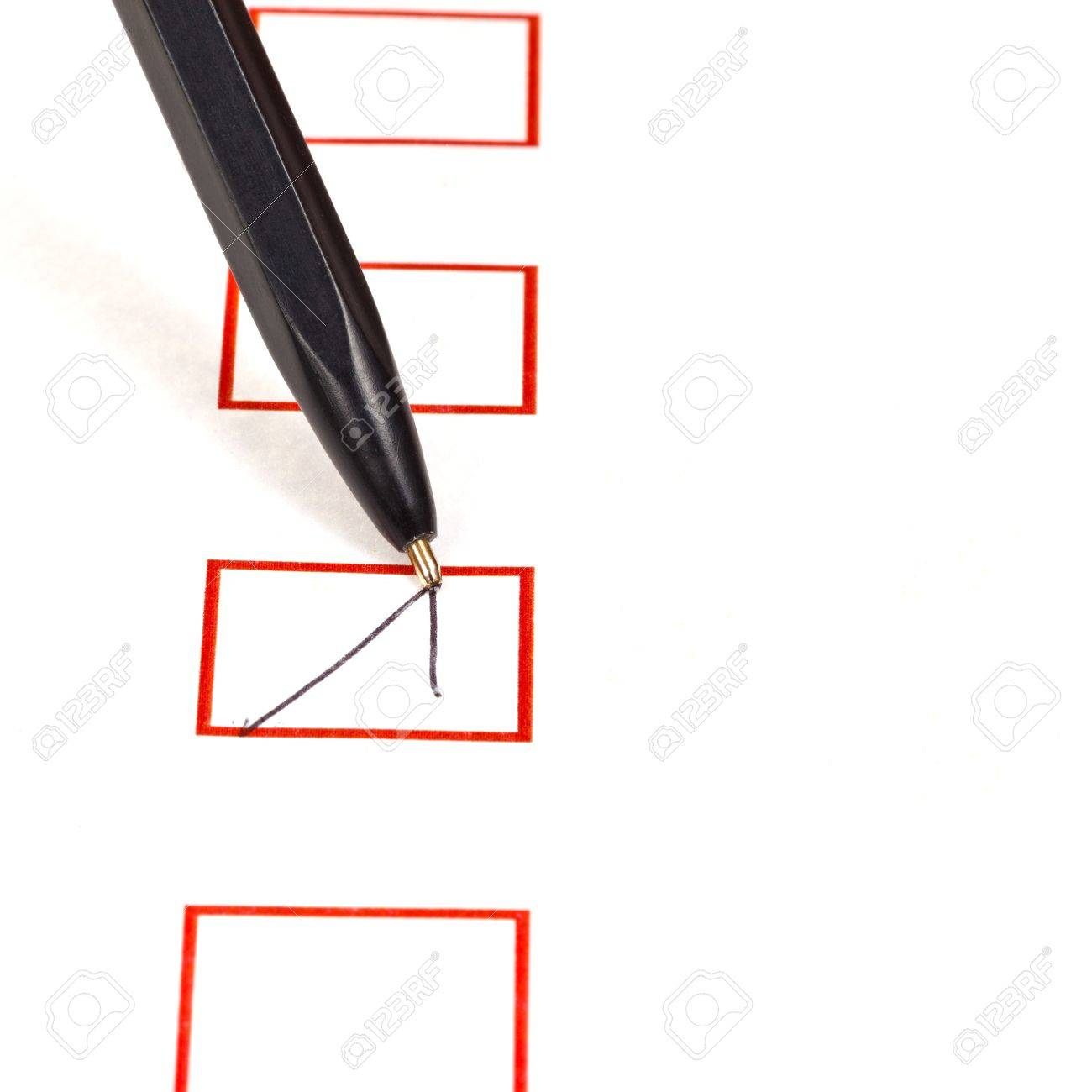 tick in red square box by simple black ballpen Stock Photo - 18215127