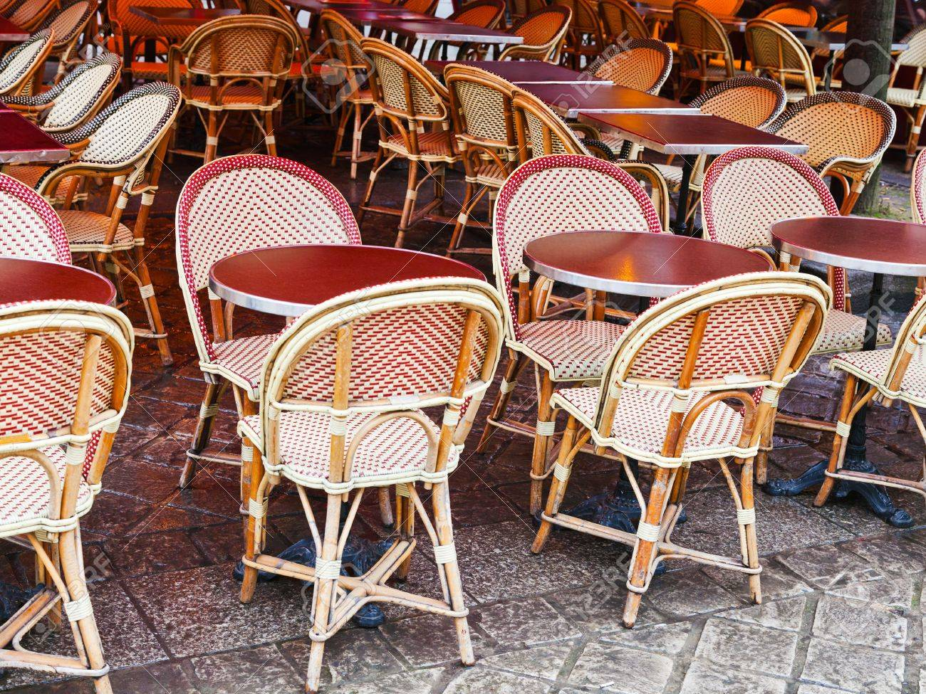 Cane Chairs And Red Table In Paris Outdoor Cafe Stock Photo   19032806