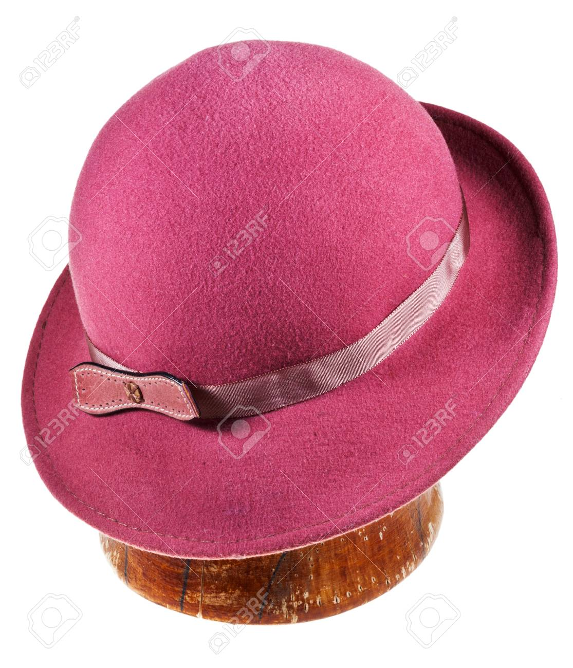 woman felt magenta hat with wide brim on wooden block isolated on white background Stock Photo - 19416623