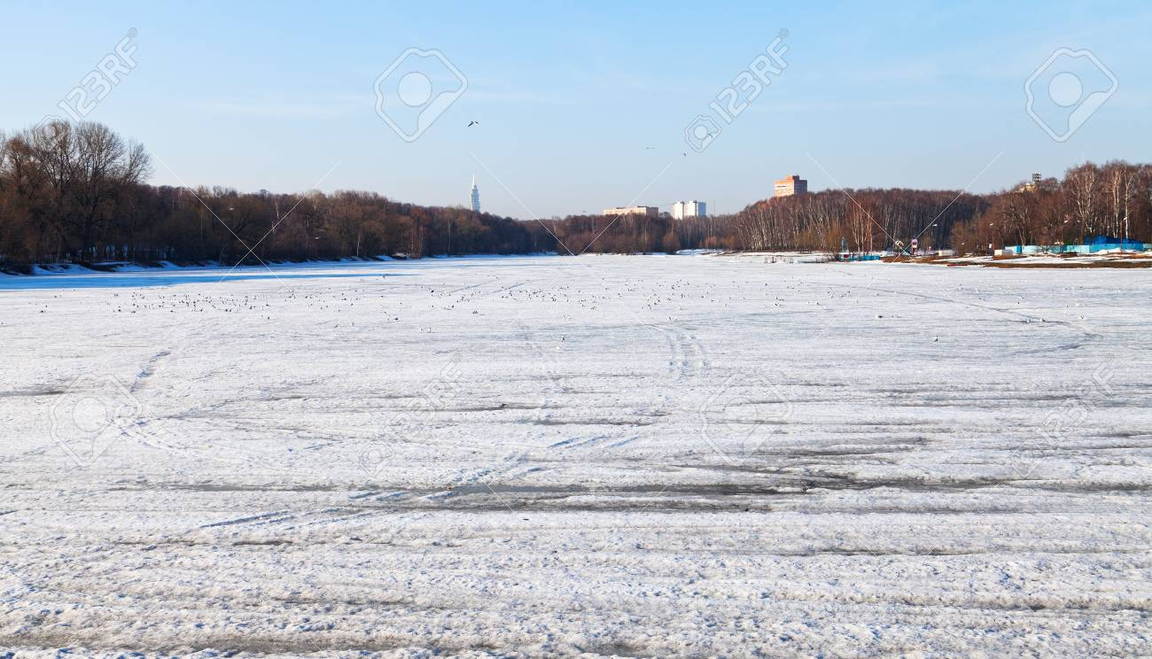 melting ice on icebound urban lake in early spring day Stock Photo - 19419258