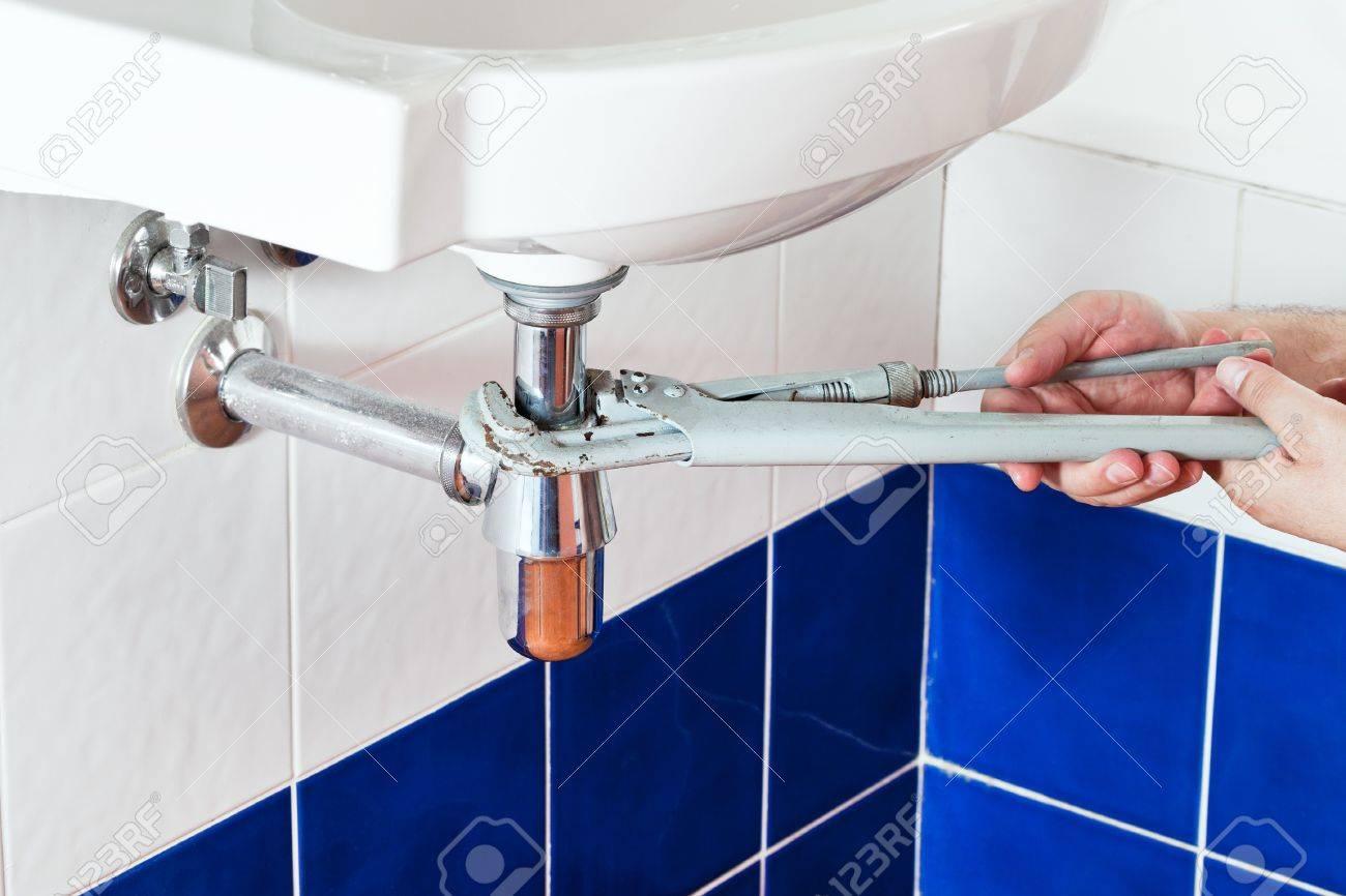 Plumber Repairing Metallic Drain Of White Sink By Pipe-wrench Stock ...