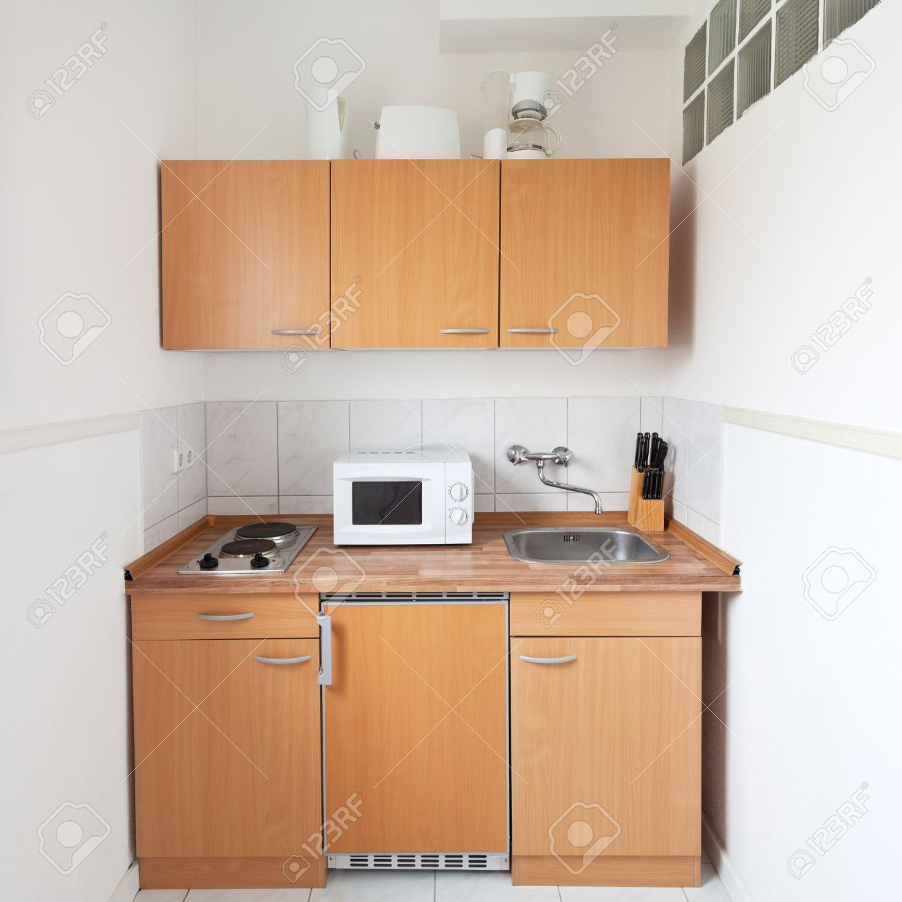 Simple kitchen with furniture set and kitchen equipment stock photo 23209106