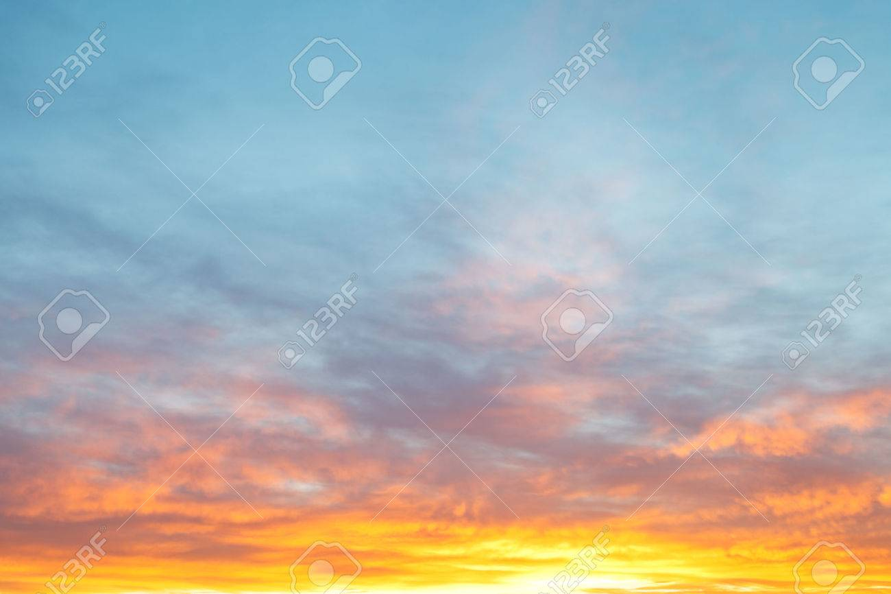 Light Blue Morning Sky Over Pastel Pink And Yellow Sunrise Clouds ...