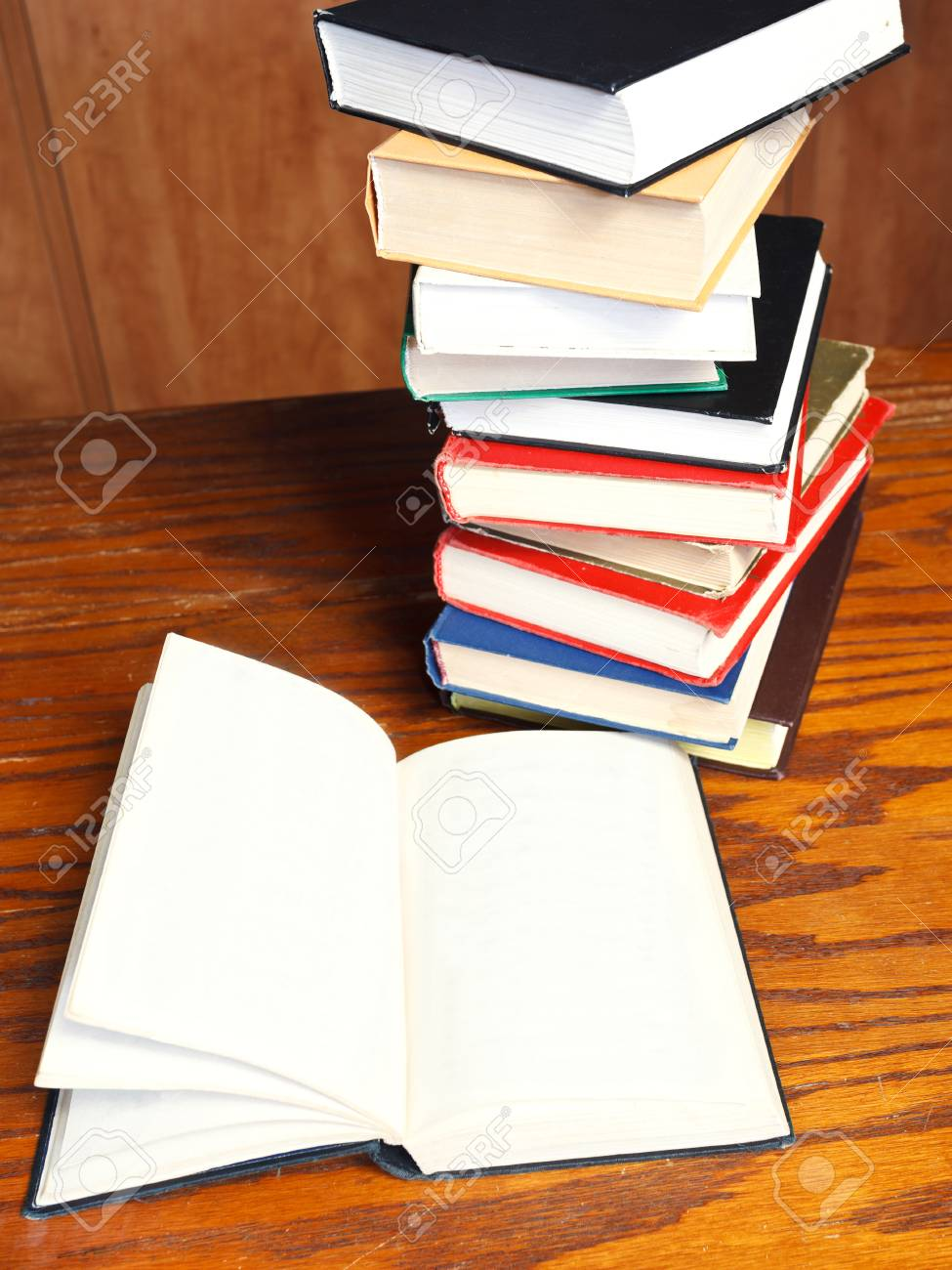 top view of blank open book on wooden table near bookcases Stock Photo - 24613901