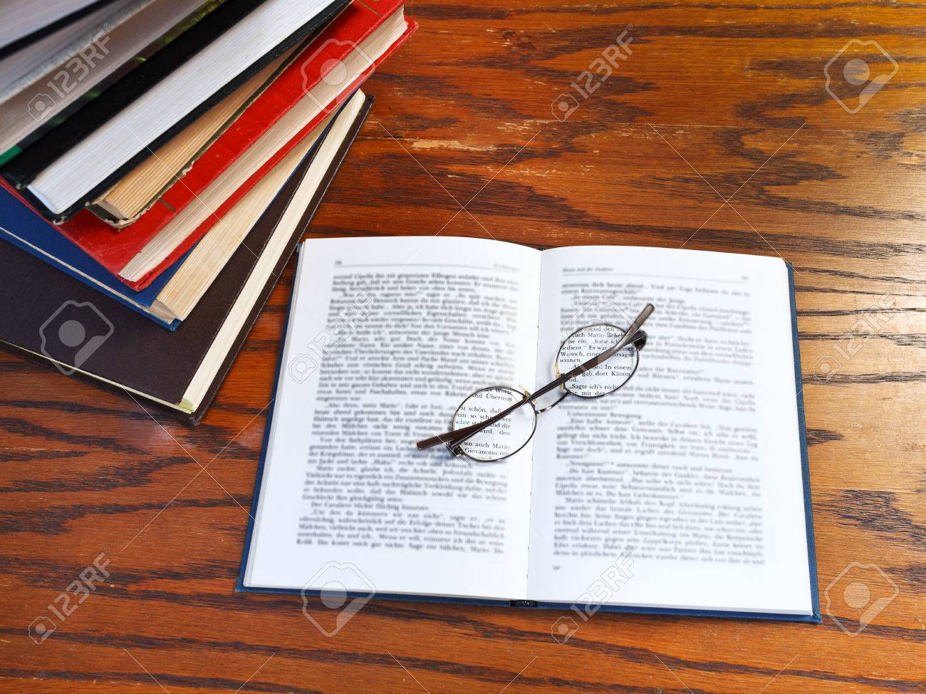 above view of blank open book and glasses on wooden table Stock Photo - 24613935