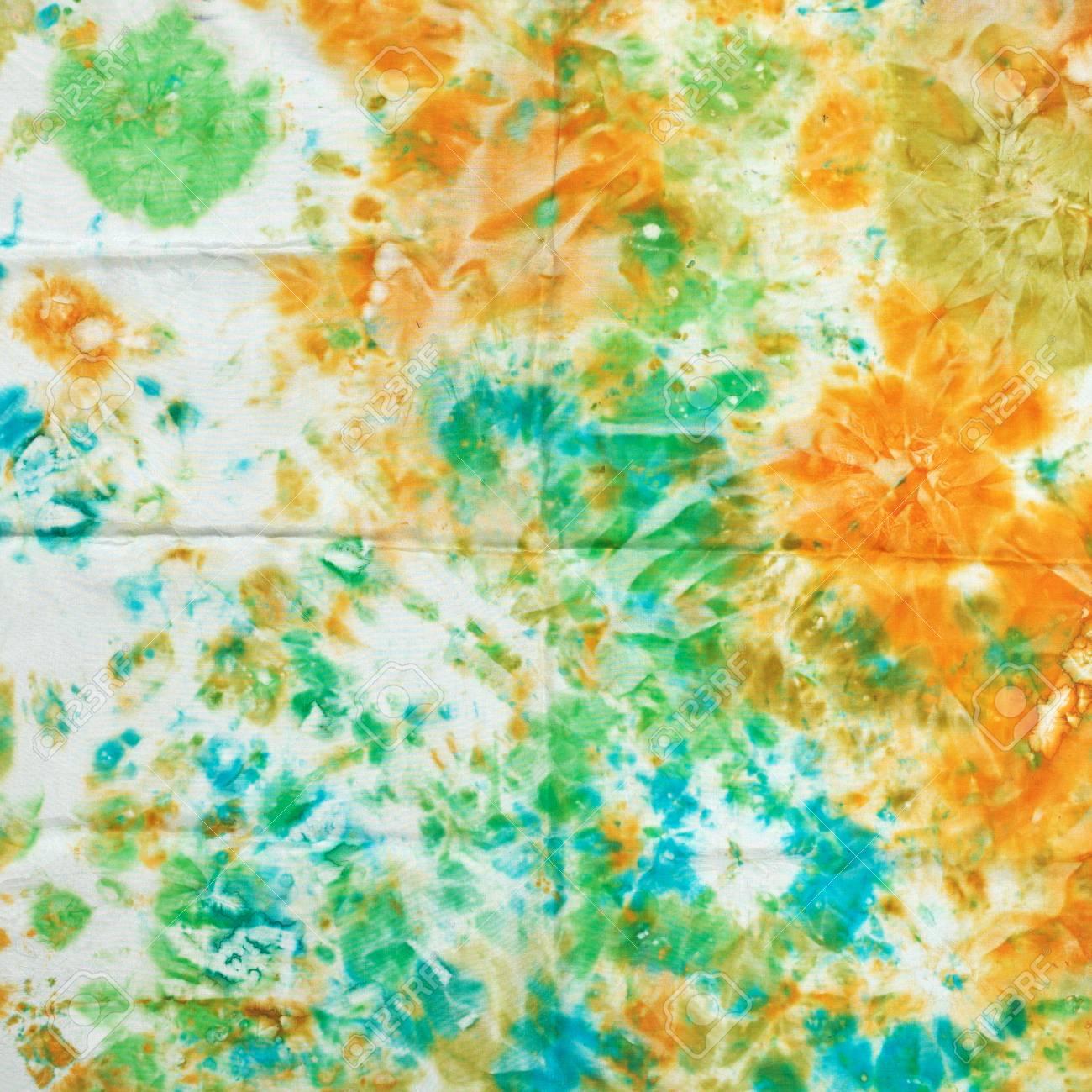 abstract nodular green and orange pattern of painted silk batik on handmade scarf Stock Photo - 25046992