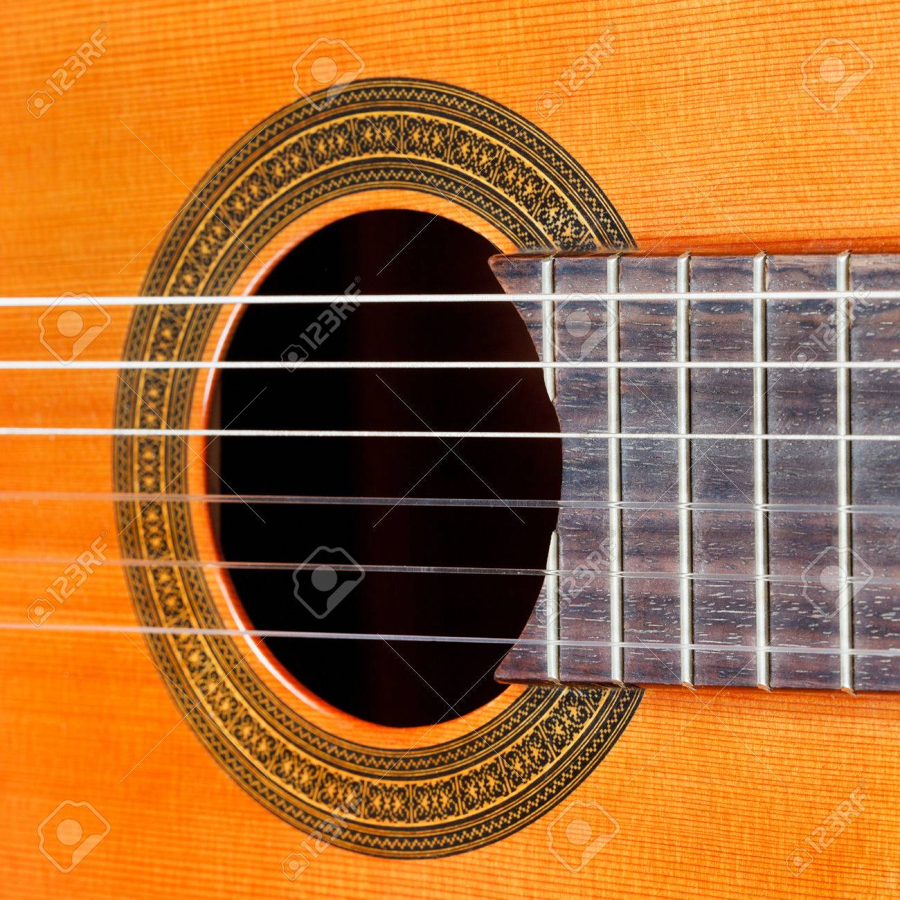 Fretboard And Sound Hole Of Classical Acoustic Guitar With Six Nylon Strings Close Up Stock Photo