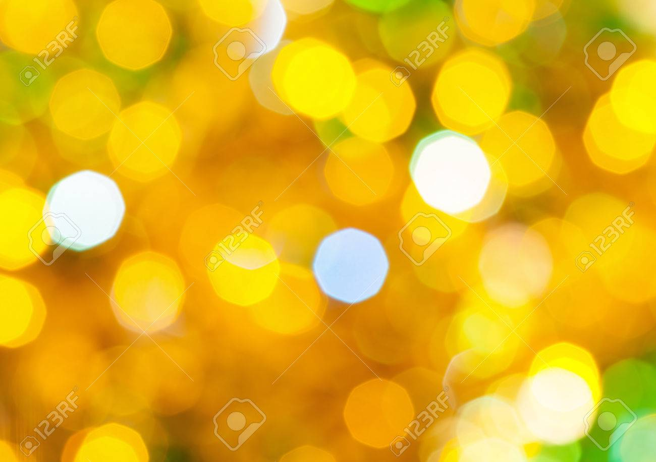 abstract blurred background yellow and green twinkling christmas lights bokeh of electric garlands on xmas