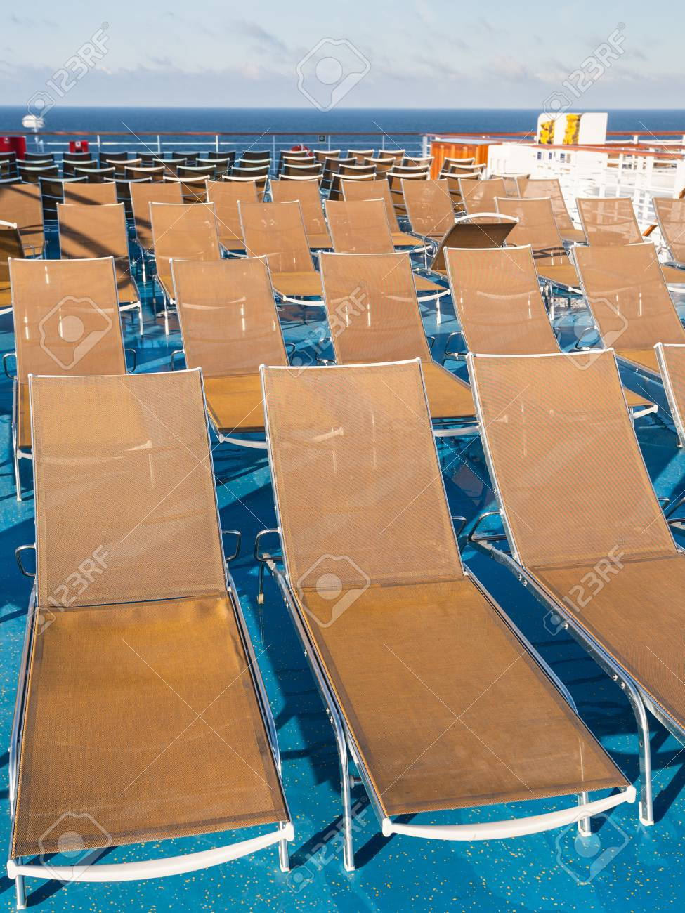 Many Empty Sunbathing Chairs On Deck Of Cruise Liner Stock Photo   71642988