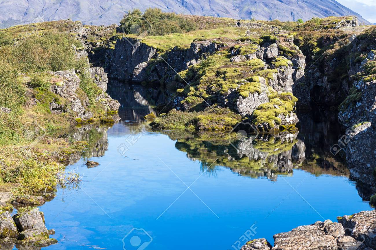 travel to Iceland - view of Silfra fissure in rift valley of Thingvellir national park in september - 90742461