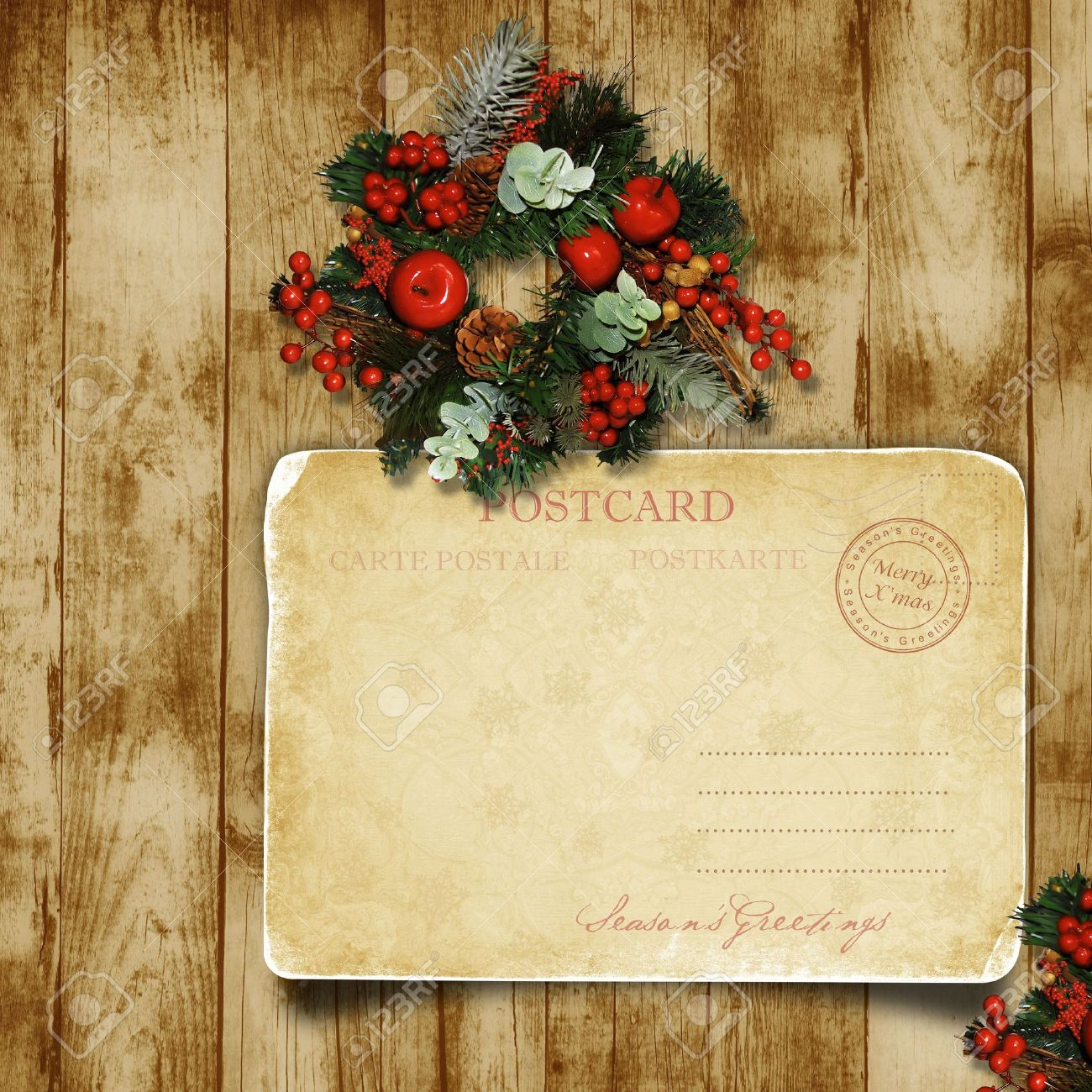 Christmas wreath on the wood door with a Christmas postcard Stock Photo - 16297466